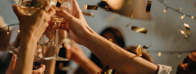 people-toasting-wine-glasses
